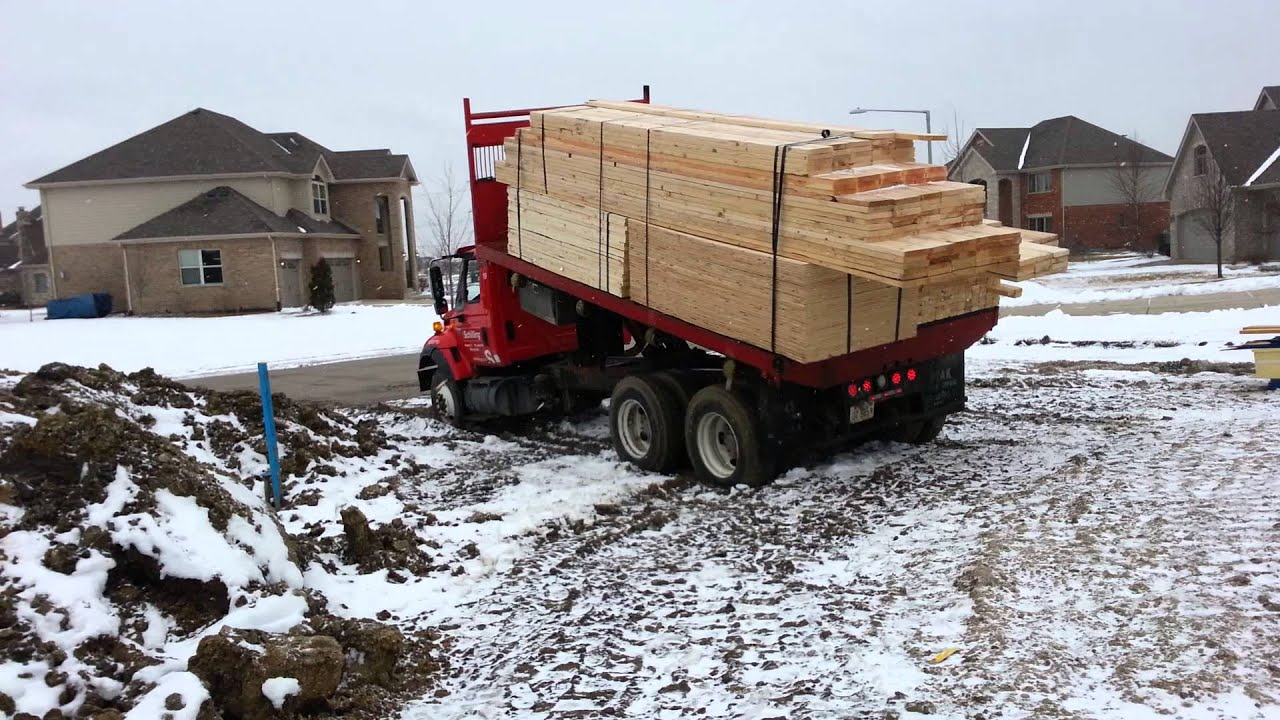 Rolling off lumber, flatbed truck - YouTube
