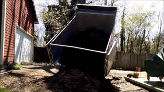 Unloading a truckload of mulch