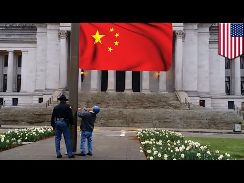 Communist flag waving: Tea partiers get help from state trooper to tear down Chinese flag