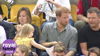 Sneaky toddler steals Prince Harry's popcorn