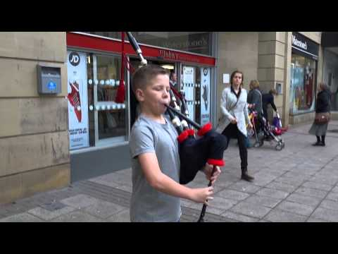 Merry Christmas From Young Scottish Bagpipers In Scotland