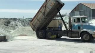 Dump Trucks at Work and raw material to make glass.