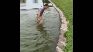 FUNNY GOLF SHOT WHERE MAN FALLS IN WATER