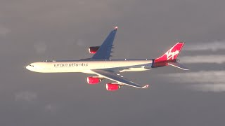 EXTREME close-up air to air race between a B747 and an A340!