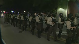 Police In Riot Gear Arrive On Scene Of Demonstration To Help Disperse Crowd
