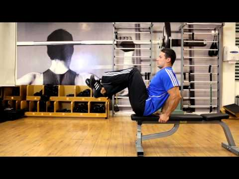 Seated Flat Bench Leg Pull In - Abs Exercise