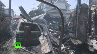 Plane crashes into homes in Tokyo killing 3 people