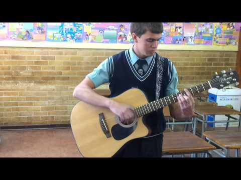 A very talented guitar player! Just showing a trick he mastered.