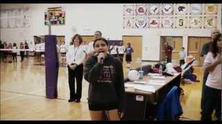 me singing the star spangled banner at varsity volleyball game