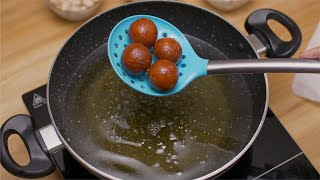 Indian Sweet - Shot of women taking out gulab jamun from hot oil