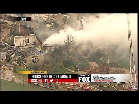 Fire crews battle massive house fire in Columbia, Illinois