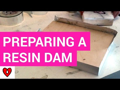 Building A Dam With Metal Tape To Pour Resin Into