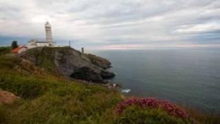 Paseo al atardecer hacia el Faro Mayor Santander.wmv