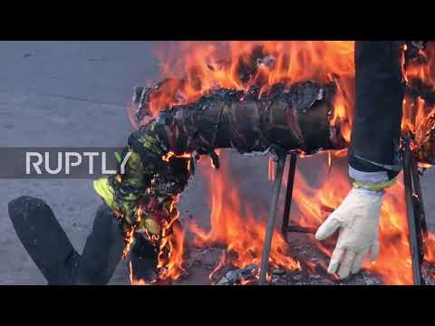 Venezuela: 'Burning of Judas' ceremony sees Trump, Maduro and Guaido effigies go up in flames
