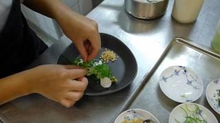 Sous Chef Dak Laddaporn makes a dish at Kiin Kiin
