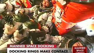 Shenzhou 9 docks with Tiangong-1