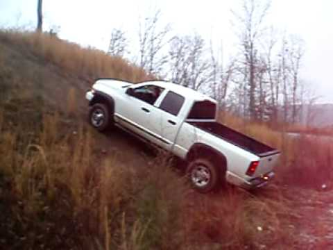 2006 Dodge Ram 2500 4X4 diesel HILL CLIMBING in the mud!!! PART 1!!!!! - YouTube