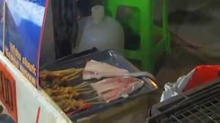 Приготовление акулы на углях. тайланд