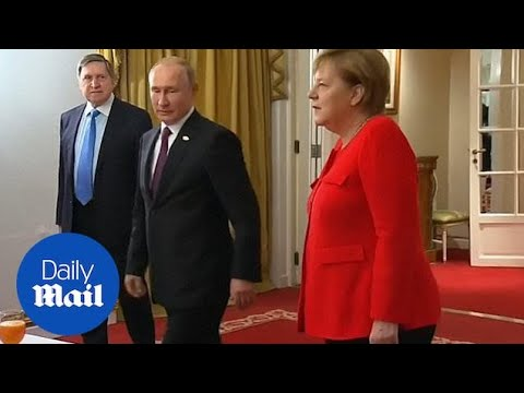 Vladimir Putin joins Angela Merkel for a G20 breakfast meeting