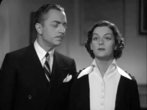 Rosalind Russell Gives William Powell a Present
