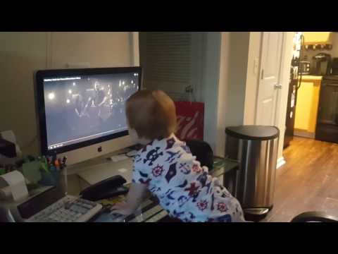 """Baby rocking out to Metallica's """"Moth Into Flame"""" 