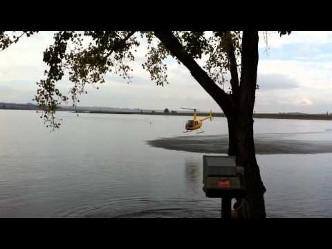 Helicopter Flying Low Over Water