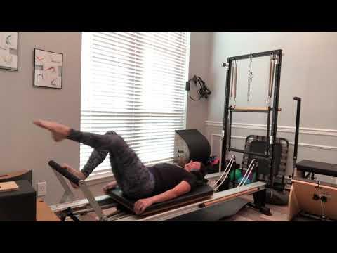 Pilates workout on a Stott Reformer