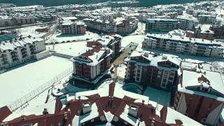 Belvedere Holiday Club, Bansko ski resort, Pirin Mountains, Bulgaria(Aerial video of Belvedere and the ski resort of Bansko. Shots taken in March 2015. More info and available apartments for sale: ..., 2015-06-10T10:37:01.000Z)