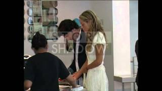 Elizabeth Berkley and her boyfriend Greg Lauren at restaurant