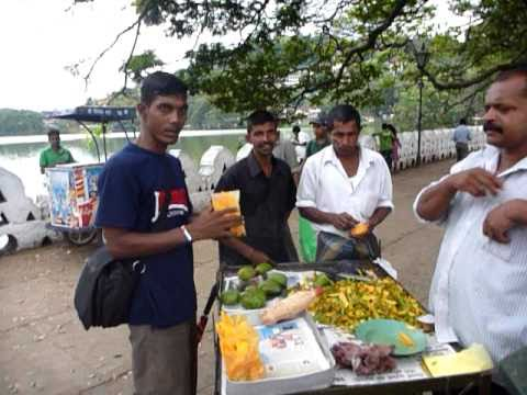 Sri Lanka,ශ්‍රී ලංකා,Ceylon, Kandy Lake: Mango Salesman with little shop