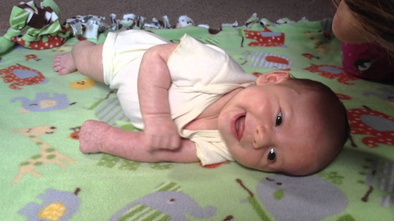 Teaching baby to roll over - YouTube