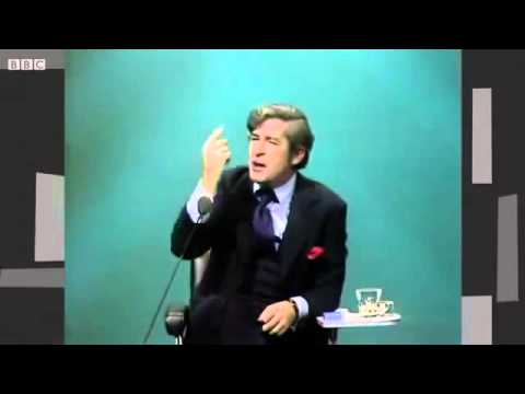 Dave Allen, looking for a black cat in a dark room