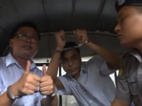 A Burma court sentenced two Reuters journalists to seven years in prison Monday for illegal possession of official documents, a ruling met with international condemnation.