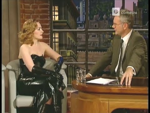 Luci van Org wearing a LATEX DRESS and leather boots in TV show!