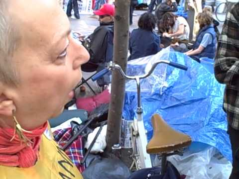 Naked Cowboy Crashes Occupy Wall Street and enrages female protestor