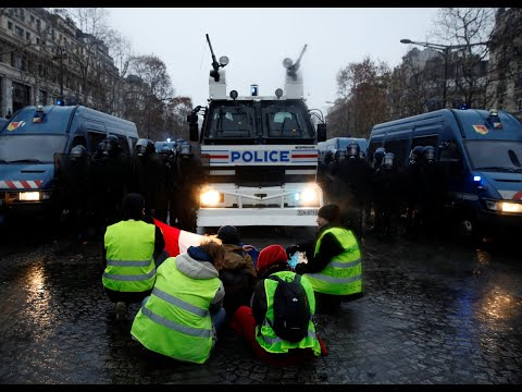 Gilets Jaunes (yellow vest) protesters gather in Paris for the fifth weekend