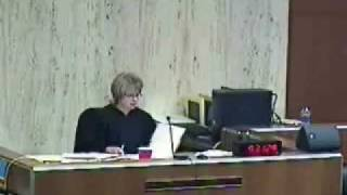 Deputy Takes Papers From Defense Table