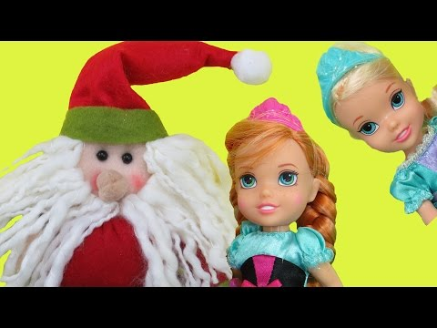 SANTA comes to ELSA & ANNA toddlers ! One of them cant find her gift! Lots of Christmas presents!
