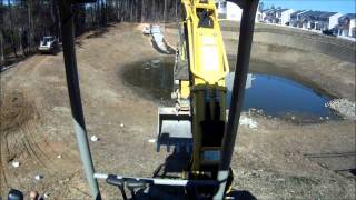 Mini Excavator loading Rip Rap