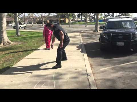 Huntington Beach Police Department  Officer Pricer Keeps A Child Distracted While Working