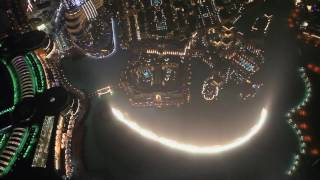 Enjoy the amazing Dubai Mall Fountains seen from the top of Burj Khalifa's