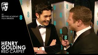 Henry Golding on the Red Carpet | EE BAFTA Film Awards 2019