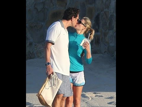 Ali Larter and Hayes MacArthur kiss on the beach in Cabo