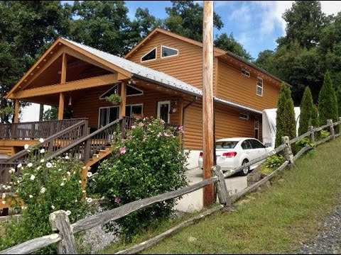 FOR SALE CUSTOM BUILT CABIN IN LITTLE SWITZERLAND NC. 28749