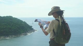 Island Hiker Reads Map Stock Video