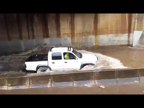 Cars Drive Through Deep Floodwaters in Adelaide