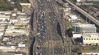 Major traffic backup on Soutwest Freeway due to overturned dump truck