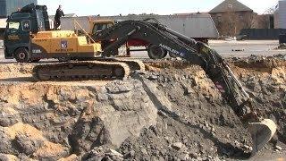 Volvo EC360B Excavator Loading Trucks