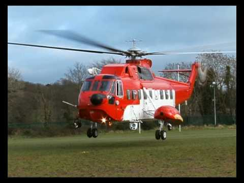 Waterford Irish Coast Guard S61N EI-CZN lands near Waterford Regional Hospital.