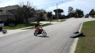 Retard on dirt bike jumping ramp
